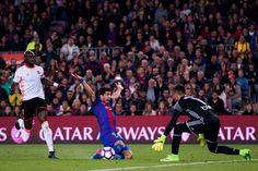 Luis Suarez of FC Barcelona falls after being fouled by Eliaquim Mangala (L) of Valencia CF during the La Liga match between FC Barcelona and Valencia CF at Camp Nou stadium on March 19, 2017 in Barcelona, Catalonia.