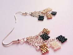 I made these adorable Confetti Earrings! Created using Delica beads in Gold, Black and White, these silver dangle earrings are sure to impress! Jewelry DIY, jewelry ideas, etsy jewelry, jewelry making,