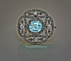 Eternity Brooch by Carl Faberge - The brooch was made in Moscow between 1899 and 1908. Silver topped gold, 4 brilliant and 162 rose diamonds, 1 aquamarine.