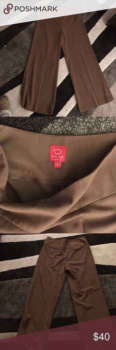 Oscar de la Renta brown trousers Size 16 brown trousers by Oscar de la Renta. These were my favorite pants but they do t fit any more. I hope some amazing lady loves them! Oscar de la Renta Pants Wide Leg