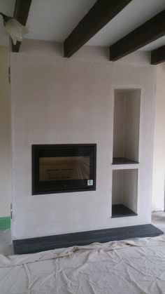 The Scan 1002 built into a bespoke fireplace, complete with two log stores.   #scan #fire #stove #bespoke #fireplace #log #store #modern #inset #contemporary #kernowfires #wadebridge #redruth #cornwall