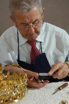 Jeweller, Bill Jameson, cleaning the Crown prior to the state opening of the Scottish Parliament on 30th June 2007.  #Scotland #History #peopleatwork
