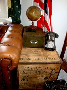 1930's Geographia terrestrial globe, 1920's tea chest as a side table, 1930's office phone and vintage filing drawer to store the tv remotes.....