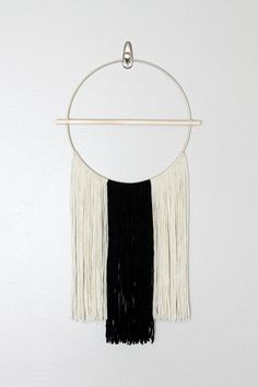 A beautiful contrast yarn wall hanging designed for the modern minimalist. Handwoven, decorated with a 14 wooden dowel secured with glue and