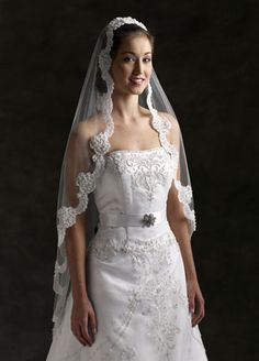 The Dorset Fingertip Wedding Veil is edged in Lace and this pretty veil is Classic and Elegant, perfect match for a Lace Wedding Gown, and is sure to please the Bride-to be!  A lovely single-layer lace edged Bridal Veil, suitable for a Church or Chapel Wedding, or for a simple ceremony in Garden or at the Beach