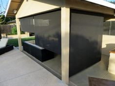 """Our customer said: """"We were looking for a few outdoor patio shades that would last and provide adequate UV blockage for under our awning. After a LOT of research, phone calls, etc. we settled on Blinds.com and were happy to see that we could order custom widths to ensure things looked even. We went with the Kona color since it provided the best shade. They not only provide great shade, they are still see-through to be able to enjoy the activities happening in the yard."""""""