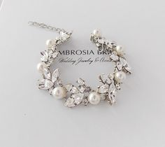 Stunning Leaf Bracelet - Swarovski Crystals and Pearls (shown in Cream) with a beautiful leaf pattern on antiqued silver plated base. Swarovski Bracelet, Bridal Bracelet, Swarovski Pearls, Crystal Bracelets, Pearl Bracelet, Wedding Jewelry, Jewelry Bracelets, Bridal Accessories, Jewelry Accessories
