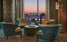 Enjoy a cocktail in the Presidential Strip-View Suite's sitting room.