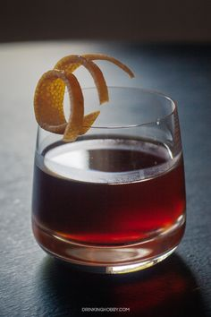 The Road Dog cocktail is a twist on a Manhattan that uses rye whiskey, Cynar, absinthe and grapefruit zest. Great up or on the rocks as a sipping cocktail. Cocktail Shots, Cocktail Garnish, Whiskey Cocktails, Cocktail Glass, Cocktail Recipes, Cocktail Ideas, Drink Recipes, Bourbon Drinks, Amaro Cocktails