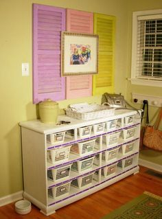Great idea for kids playroom. Lots of storage.  Dont toss the old dressers!  Like the shutters as well, nice art work to complete the look.