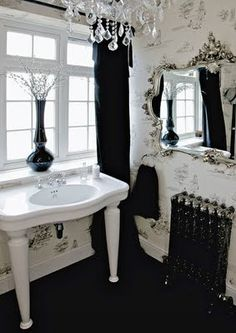 Love the subtle toile wallpaper, the mirror, chandelier and sink