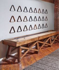 This shuffleboard table will fit perfectly in a rustic man cave! http://www.BilliardFactory.com/Travis-Shuffleboard-Table