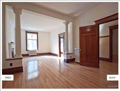 Colonnes, boiseries foncées, plancher pâle, division plus aérée du salon double avec les colonnes