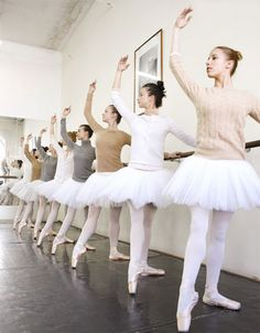 ballerinas wearing cashmere sweaters with their tutus and pointe shoes