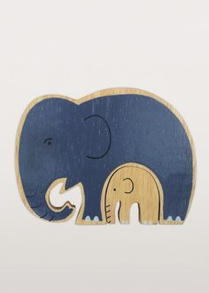 Our new items have not forgotten the children in our lives. A mama elephant keeps her baby safe and snug in this charming, painted rubberwood 2-piece puzzle. Give a fair trade baby shower gift you believe in. Handmade in Sri Lanka.