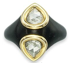 A WOOD AND DIAMOND RING, BY JAR The ebony hoop is inlaid with two rose-cut pear-shaped diamonds, each in a gold wire setting. Christie's.