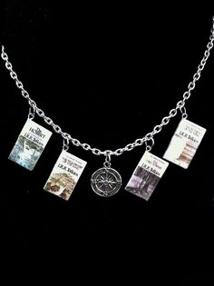 Hey, I found this really awesome Etsy listing at https://www.etsy.com/listing/198815159/tolkien-mini-book-necklace-with-compass