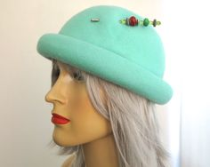 Vintage wool felt turquoise bowler hat with rolled over brim, pretty hat pin with green, red, orange beads, River Island, made in England by…