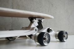 An 8-wheeled skateboard that works on stairs.