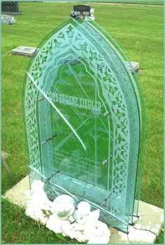 Tombstone made of glass panes. While quite attractive, I think glass and resin markers are still experimental. Though hard to break, they do do suffer stress cracks and as they age; resin gets cloudy.