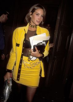 Monochrome primary colors made the skirt suit a power suit of sorts. Fashion girls like Christy Turlington wore them with a sheer mesh top and chain-link accessories.