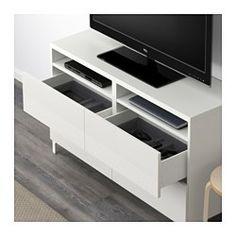 IKEA - BESTÅ, Meuble télé avec tiroirs, blanc/Selsviken brillant/blanc, glissière tiroir, fermeture silence, , Les tiroirs se referment doucement en silence grâce à la fonction intégrée de fermeture en douceur.Vous pouvez facilement dissimuler les câbles du téléviseur et tout autre équipement tout en les ayant à portée de main grâce aux ouvertures pratiquées au dos du meuble télé.Le passe-câbles sur la partie supérieure de l'élément permet de regrouper et d'orienter facilement les…