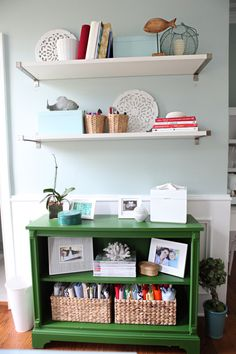 functional but pretty white shelves + funky painted bookshelf in the craft room/home studio