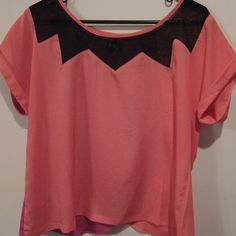 Cute Blouse. (Size M) Cute blouse with black netting around the neck. It is orange and fuchsia pink. Worn twice. Great condition. No trades. Size M. Cute top to pair with white pant! Tops Blouses