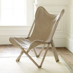 Butterfly Chair:   The relaxed butterfly-shaped seat and folding frame are direct descendents from the classic 19th century British colonial campaign chair. Cover is natural 100% linen and removes for easy cleaning. Hand assembled, solid oak frame collapses into a neat, compact bundle when you're ready to move camp.