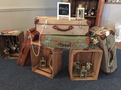 Vintage suitcases and wooden apple crates, by Lily King Weddings