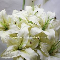 White Lily in brides hair.  Floating centerpieces in big vase