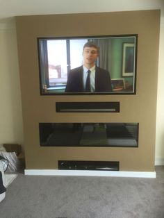 I like the part in the middle for AV devices Tv Above Fireplace, Fake Fireplace, Fireplace Built Ins, Fireplace Design, Best Electric Fireplace, Wall Mount Electric Fireplace, Feature Wall Living Room, Living Room Tv, Wall Gas Fires