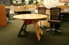 Tables Among the Cubes  | The tables are dispersed through out the office, adding individuality to the cube set up.
