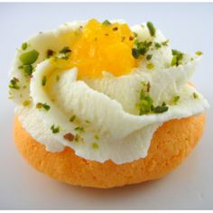Orange Blossom -- spongy orange rasgulla topped with a beautiful swirl of paneer -- #indian_sweets #mithai