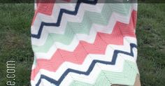 Well it's about time I posted about this! I'm sure you have seen this mint green, coral, white, and navy blue chevron baby blanket in pret...