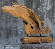 Made of natural teak wood. Each horse sculpture piece is handcrafted making it unique. Sizes will vary. Cracks and variations in the grain are normal.