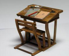 Miniature old fashioned school desk