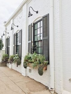 Outside of Magnolia Bakery.Beautiful idea for black shutters and window boxes on a brick house for curb appeal. Farmhouse Shutters, Farmhouse Windows, Rustic Shutters, Diy Shutters, Window Shutters Exterior, Houses With Shutters, Outside Window Shutters, Barn Windows, Indoor Shutters