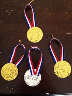 "Girl Scout SWAPS: gold medal swaps for our Olympic themed ""going for the gold"" overnight trip to Golds Gym... I used gold glittered card stock and hot glued red white and blue ribbon add a pin & done!..."