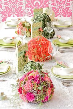 So interesting and colorful carnations make a great sphere for a different centerpiece look for your bridal reception tables orange pink and green/ central florida wedding flowers/ www.callaraesfloralevents.com