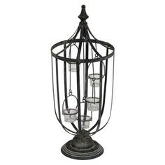 """Antiqued iron candleholder. Holds five votive candles.Product: Candleholder    Construction Material: Iron and glass    Color: Soft black    Features: Beautifully weathered Accommodates:  (5) Votive candles - not included  Dimensions: 26"""" H x 10"""" Diameter    Cleaning and Care: Wipe clean with damp cloth"""