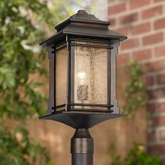This outdoor post mount light features a Mission style top lantern with with vintage-look frosted cream textured glass. Outdoor Sconces, Outdoor Light Fixtures, Patio Lighting, Rustic Lighting, Pillar Lights, Window Grill Design, Stone Pillars, Outdoor Post Lights, Lanterns