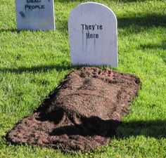 More Scary DIY Outdoor Halloween Decorations use old towel and dye brown, spray glue, mulch and newspaper.