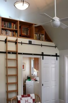 A track with a library ladder for the loft and a track for a sliding door as well