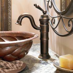 Single Handle Vessel Sink Faucet In Bronze.