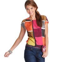cute mod pop art top! Colorblock Squares Short Sleeve Top - Incredibly vibrant, this fluid top adds an unforgettably chic pop to your dinner-and-drinks routine. Scoop neck. Short dolman sleeves. Gathered beneath neckline. Rounded hem.