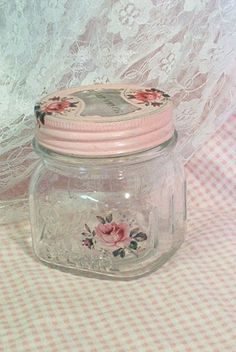 re-purposed jar.  paint top, decoupage, and voila, shabby chic for pennies.