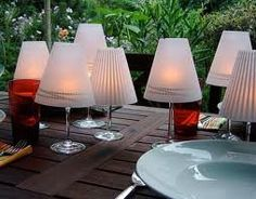 Dollar Tree Centerpieces. Wine glasses and vellum with tea lights or flicker candles.