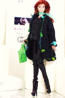 the outfit includes:a black satin suita felt coat with wool trimminga pair of black leather high heel bootiesa green leather baga black leather pursetwo scarvesa pair of earrings it fits Fashion Royalty, Barbie and similar 1/6 dollsbag does not openWorldwide shipping is included