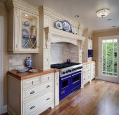 Elegant country style kitchen (Cultivate.com)  Fabulous stove!!!   Love the blue & white!!!!